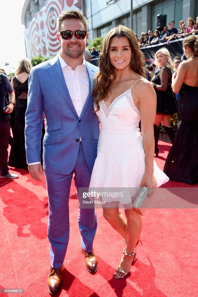 Race car drivers Ricky Stenhouse Jr. (L) and Danica Patrick attend The 2017 ESPYS at Microsoft Theater on July 12, 2017 in Los Angeles, California.