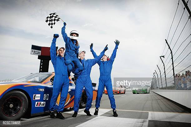 race car drivers winning car race - racing driver stock pictures, royalty-free photos & images