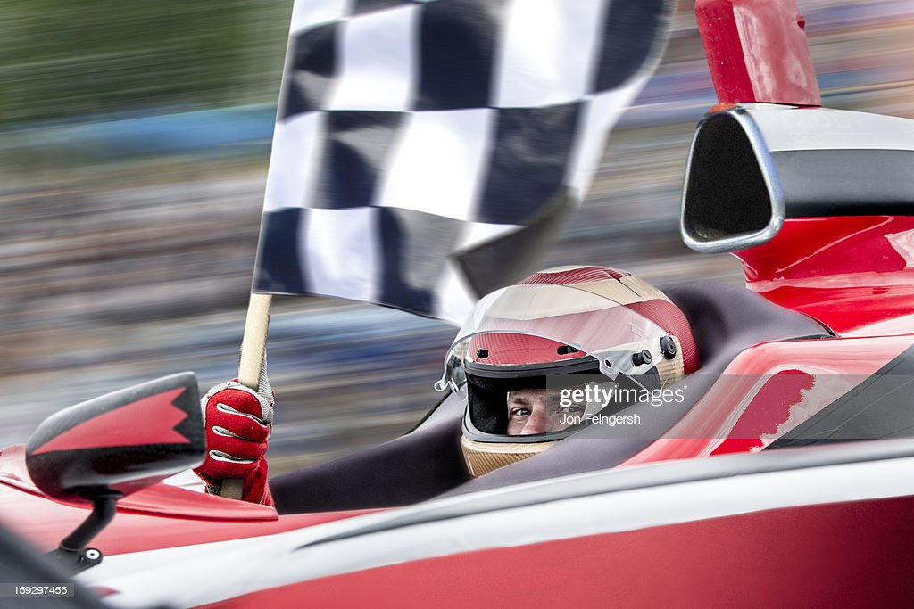 INDY race car winner with checkered flag. : Stock Photo