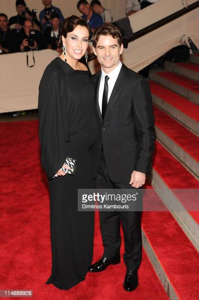 Race care driver Jeff Gordon and Ingrid Vandebosch attend the Costume Institute Gala Benefit to celebrate the opening of the American Woman...