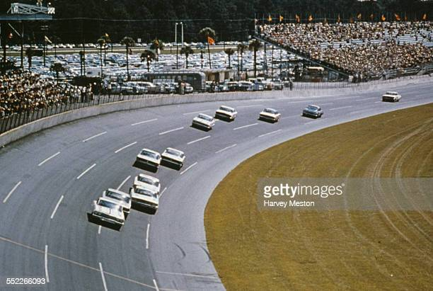 Race cars on the banking at the Daytona International Speedway race track Daytona Beach Florida USA circa 1960