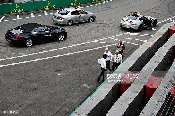 Race Director Charlie Whiting and Herbie Blash FIA Deputy Race Director inspect the track barriers before final practice for the Formula One Grand...