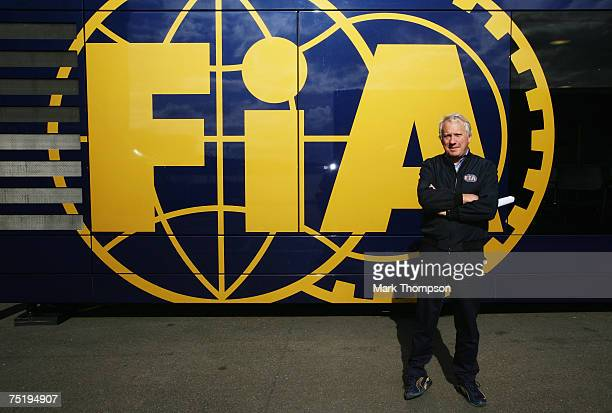 A race Director Charlie Whiting poses for a photograph in the paddock during practice for the British Formula One Grand Prix at Silverstone on July 6...