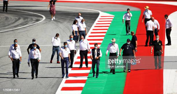 Race Director Michael Masi and other members of the FIA inspect the track during previews for the F1 Grand Prix of Austria at Red Bull Ring on July...