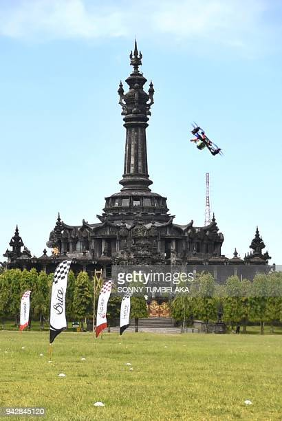 A race drone flies in front of the Bajra Sandhi monument during the FAI Drone Racing World Cup event in Denpasar on Indonesia's resort island of Bali...