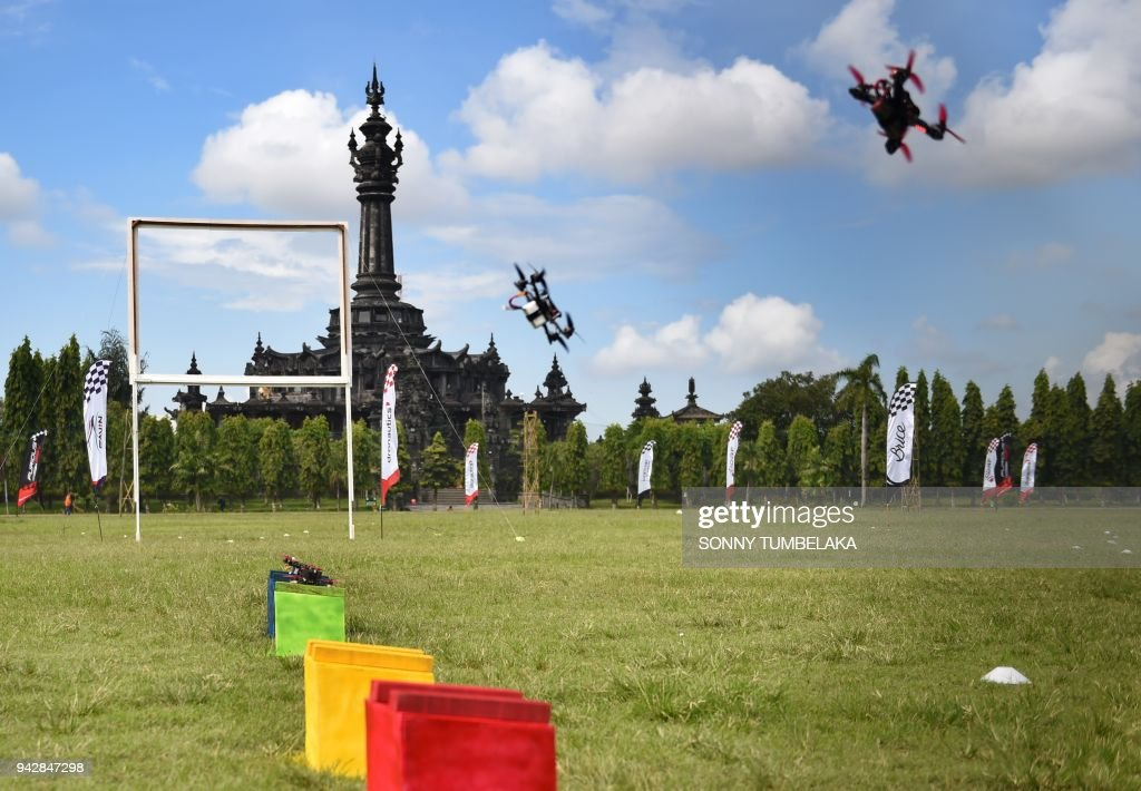 Race drones flies in front of the Bajra Sandhi monument during the FAI Drone Racing World Cup event in Denpasar on Indonesia's resort island of Bali on April 7, 2018. /