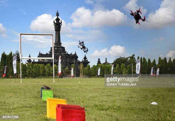Race drones flies in front of the Bajra Sandhi monument during the FAI Drone Racing World Cup event in Denpasar on Indonesia's resort island of Bali...