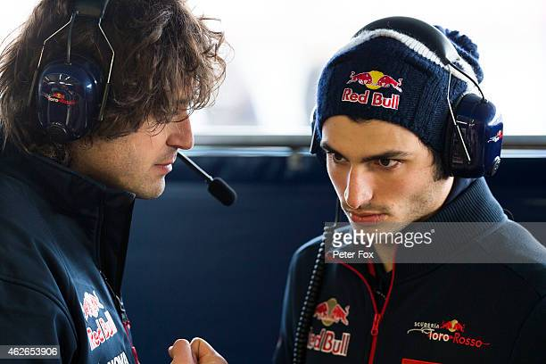 Race engineer Marco Matassa of Toro Rosso chats with Carlos Sainz Jnr of Toro Rosso and Spain during day two of Formula One Winter Testing at...