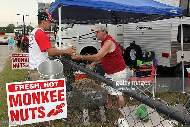 A race fan purchases boiled peanuts prior to the NASCAR Sprint Cup Series Bojangles' Southern 500 at Darlington Raceway on May 12 2012 in Darlington...