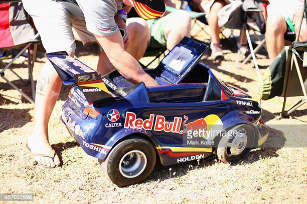 A race fan reaches into a decorated esky for a beer during the V8 Supercars Bathurst 1000 weekend at Mount Panorama on October 11 2014 in Bathurst...