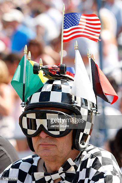 Race fan watches the action during Miller Lite Carb Day practice for the IRL IndyCar Series 93rd running of the Indianapolis 500 on May 22, 2009 at...