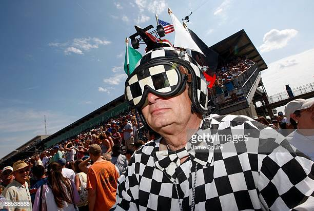A race fan watches the action during Miller Lite Carb Day practice for the IRL IndyCar Series 93rd running of the Indianapolis 500 on May 22 2009 at...