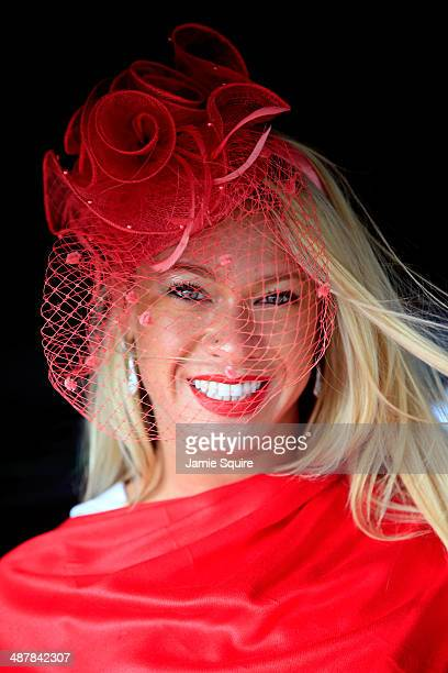 A race fan wearing a festive hat poses prior to the 140th running of the Kentucky Oaks at Churchill Downs on May 2 2014 in Louisville Kentucky