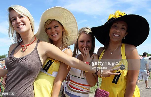 Race fans celebrate from the infield prior to the 135th running of the Preakness Stakes at Pimlico Race Course on May 15, 2010 in Baltimore, Maryland.