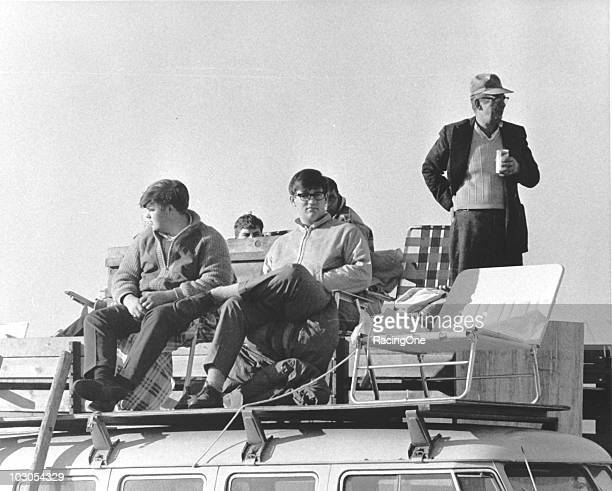 Race fans enjoy the NASCAR action from a makeshift grandstand atop a Volkswagen bus in the infield