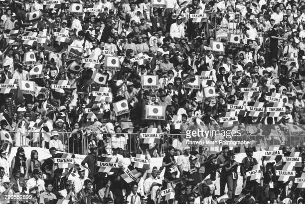 Race fans hold up banners and flags to show their support forTakuma Sato of Japan driver of the Lucky Strike BAR Honda BAR 006 Honda RA004E V10...