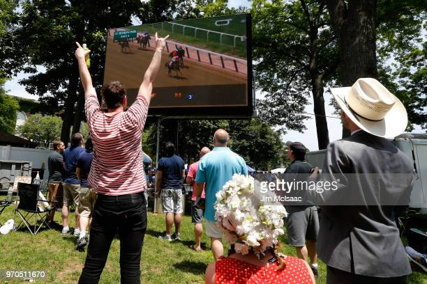 Race fans react to an earlier race ahead of the the 150th running of the Belmont Stakes at Belmont Park on June 9 2018 in Elmont New York