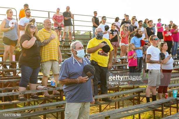 Race fans stand for the U.S. National anthem at Delaware International Speedway on June 6, 2020 in Delmar, Delaware. Last week, Delaware...