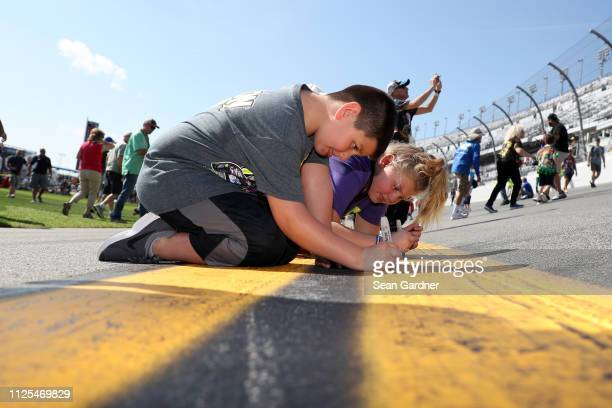 Race fans stand in the infield prior to the Monster Energy NASCAR Cup Series 61st Annual Daytona 500 at Daytona International Speedway on February...