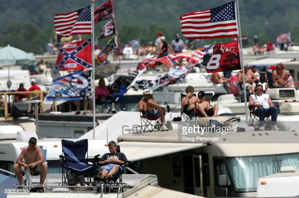Race fans take to the roofs of their RVs in the infield for a better view of the NASCAR Nextel Cup Pocono 500 on June 12, 2005 at the Pocono Raceway...