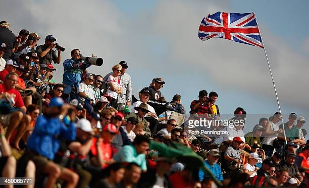 Race fans watch qualifying for the United States Formula One Grand Prix at Circuit of The Americas on November 16 2013 in Austin United States