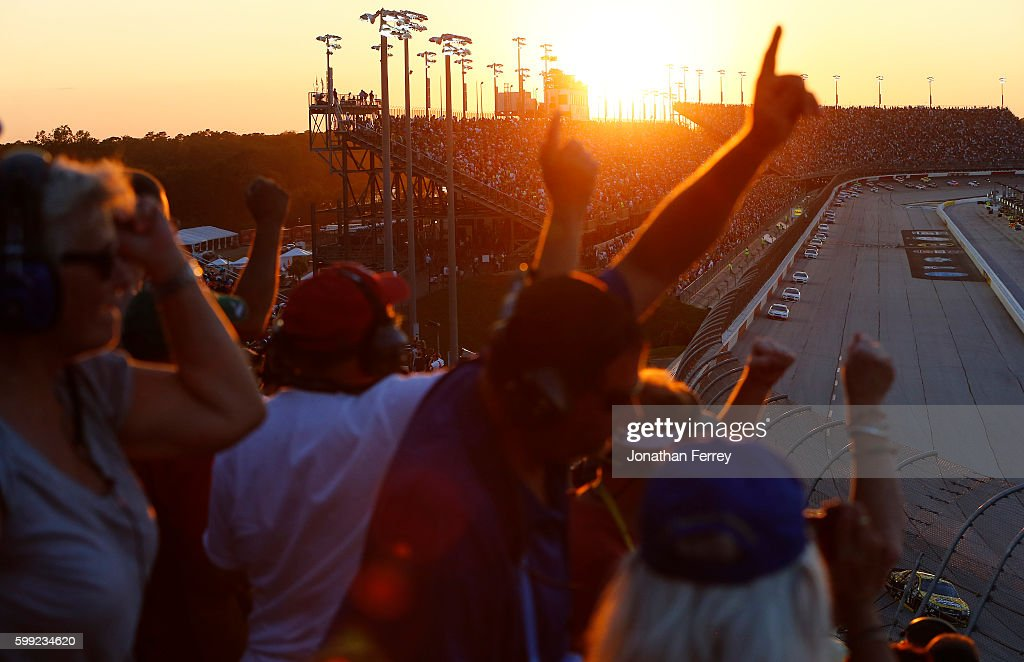 Race fans watch the NASCAR Sprint Cup Series Bojangles' Southern 500 during sunset at Darlington Raceway on September 4, 2016 in Darlington, South Carolina.