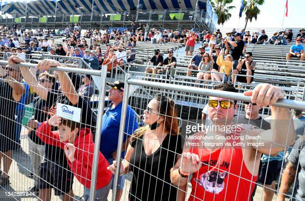 Race fans watching the Stadium Super Trucks catch some air off the ramps on the second day of the Acura Grand Prix of Long Beach in Long Beach on...