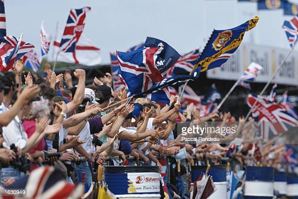 Race fans wave fans and enjoy the sunshne during the British Grand Prix at the Silverstone circuit in England. \ Mandatory Credit: Pascal...