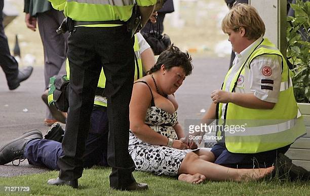 Race goer is tended to by paramedics at Ladies' Day during the third day of Royal Ascot at the Ascot Racecourse on June 22, 2006 in Berkshire,...