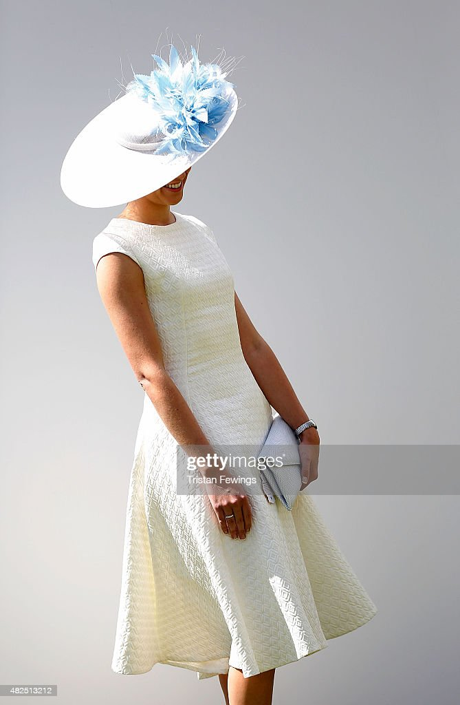 A race goer on day four of the Qatar Goodwood Festival at Goodwood Racecourse on July 31, 2015 in Chichester, England.