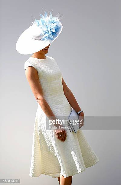 A race goer on day four of the Qatar Goodwood Festival at Goodwood Racecourse on July 31 2015 in Chichester England