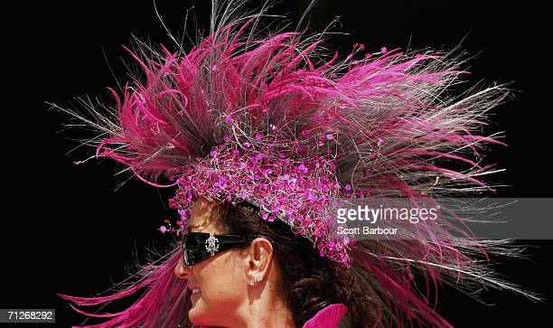 A race goer Rebecca Shaw wears a hat designed by Elida Hats as she enjoys the atmosphere at Ladie's Day during the third day of Royal Ascot at the...
