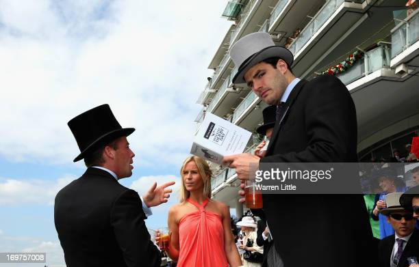 Race goers are pictured at The Derby Festival at Epsom Racecourse on June 1, 2013 in Epsom, England.
