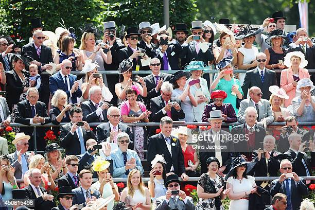 Race goers enjoy the atmosphere during day two of Royal Ascot at Ascot Racecourse on June 18 2014 in Ascot England