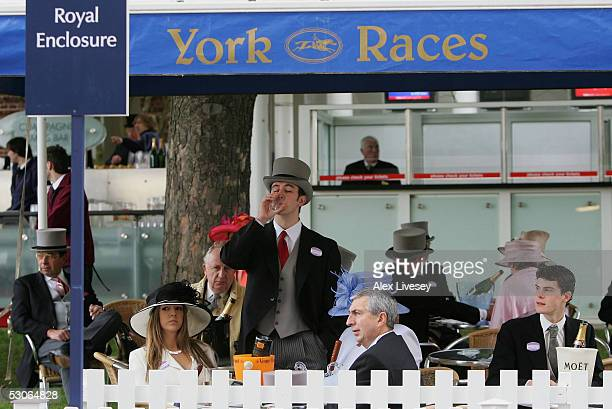 Race goers enjoy the hospitality in the Royal Enclosure during the first day of Royal Ascot held at York Racecourse on June 14, 2005 in York, England.