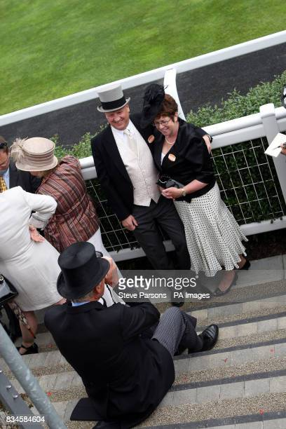 Race goers enjoy the second day at Ascot Racecourse Berkshire