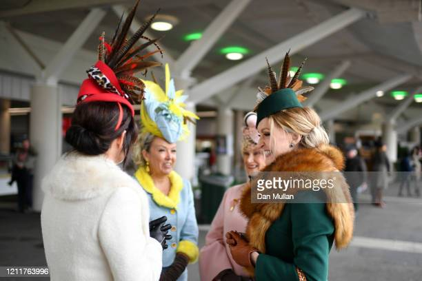 Race goers in decorative hats arrive for Ladies Day at Cheltenham Racecourse on March 11, 2020 in Cheltenham, England.