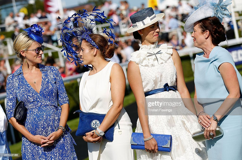 Race goers in the Best Dressed competition on day four of the Qatar Goodwood Festival at Goodwood Racecourse on July 31, 2015 in Chichester, England.