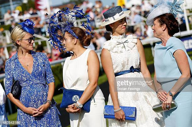 Race goers in the Best Dressed competition on day four of the Qatar Goodwood Festival at Goodwood Racecourse on July 31 2015 in Chichester England