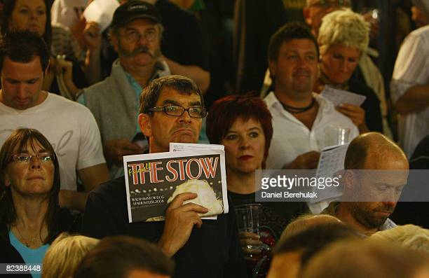 Race goers observe race results during the farewell gala evening at Walthamstow Greyhound Stadium on August 16 2008 in London England The famous...