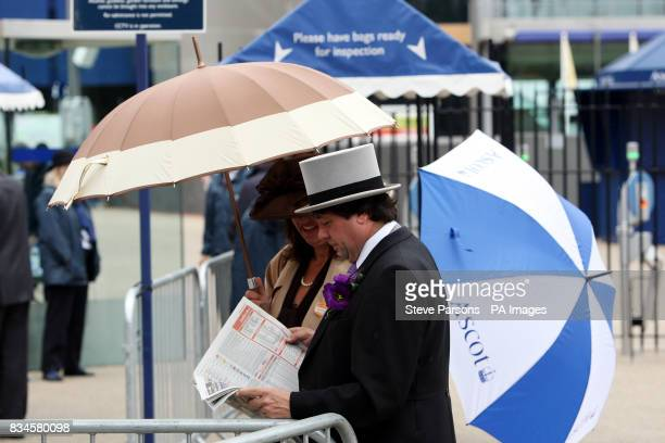 Race goers prepare for the second day at Ascot Racecourse Berkshire