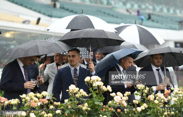 Race goers watch on during 2019 Derby Day at Flemington Racecourse on November 02 2019 in Melbourne Australia