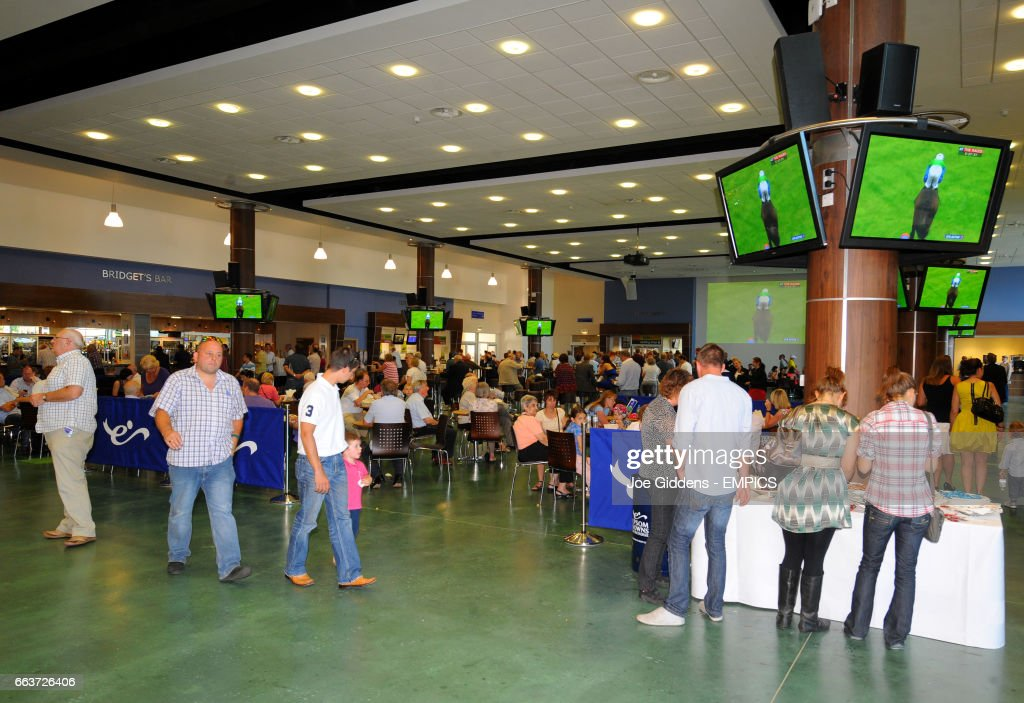 Race goers watch the action in the hospitality areas at Epsom Downs