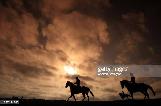 Race horses are seen exercising on Epsom Downs on May 28 2020 in Epsom England The British government continues to ease the coronavirus lockdown by...