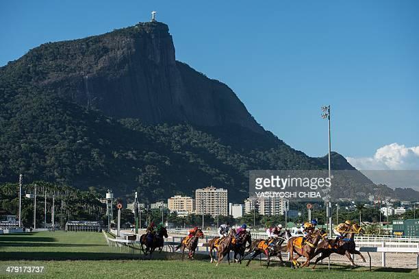 Race horses compete during the Rio de Janeiro's G1 derby Zelia Gonzaga Peixoto de Castro in Rio de Janeiro Brazil on March 16 2014 Race horse Bal A...