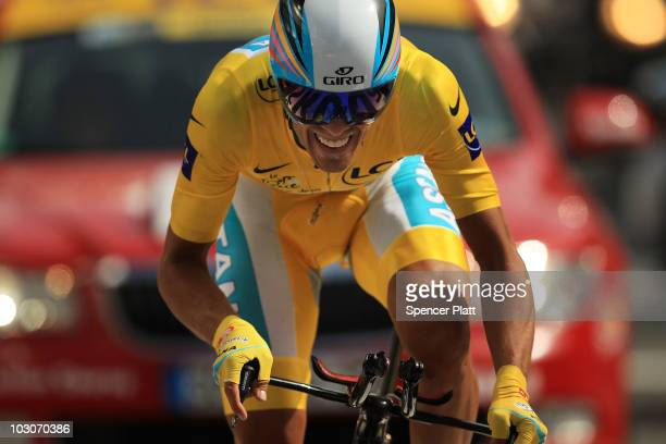 Race leader Alberto Contador of team Astana crosses the finish line in the yellow jersey following stage 19 of the Tour de France on July 24, 2010 in...