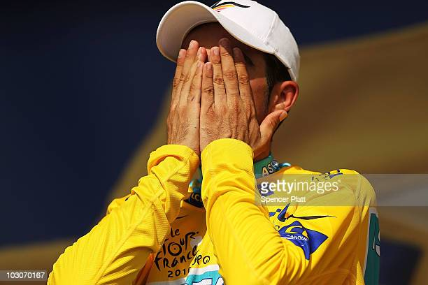 Race leader Alberto Contador of team Astana stands on the podium in the yellow jersey following stage 19 of the Tour de France on July 24, 2010 in...