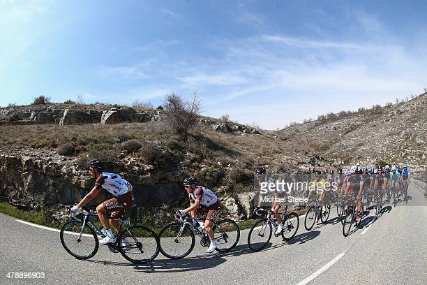 Race leader and yellow jersey Carlos Gomez Betancur of Colombia and AG2R La Mondiale is protected by team mates lead by Sebastien Minard of France up...