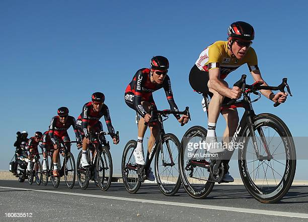 Race leader Brent Bookwalter of the USA and the BMC Racing Team rides with his team during stage two of the 2013 Tour of Qatar, a 14km Team Time...