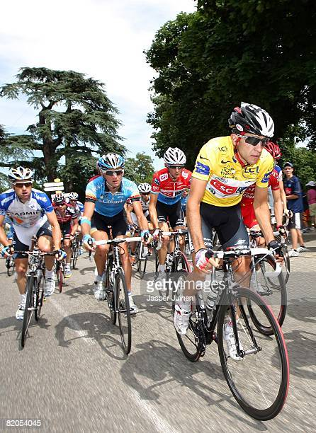 Race leader Carlos Sastre of Spain and team CSC Saxo Bank climbs in the yellow jersey amid the peloton up the Croix de Montvieux during stage...